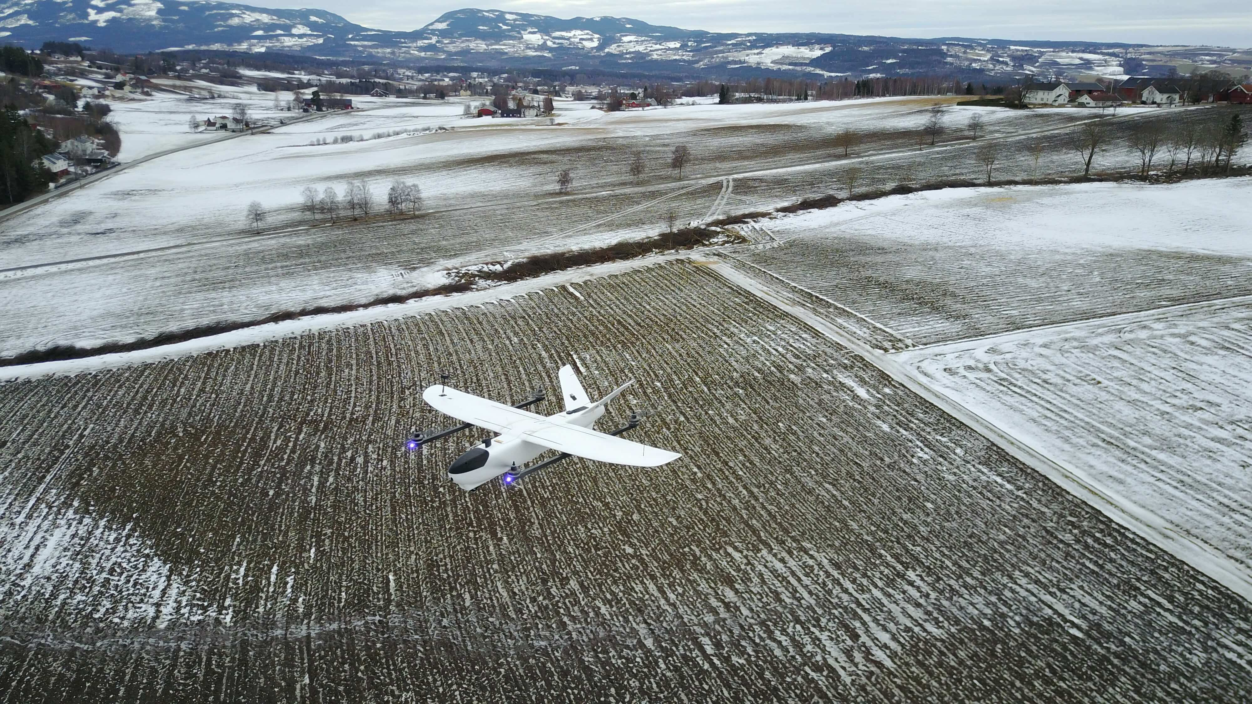 Vtol hybrid  prototype UAV hovering over field